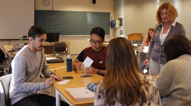 Students practice speaking Norwegian together at HiMolde, with Norwegian teacher Marit Viken (right) listening in. Photo: Nancy Le